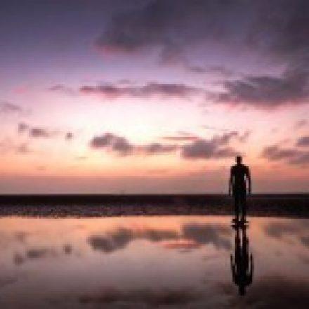 man beach dawn